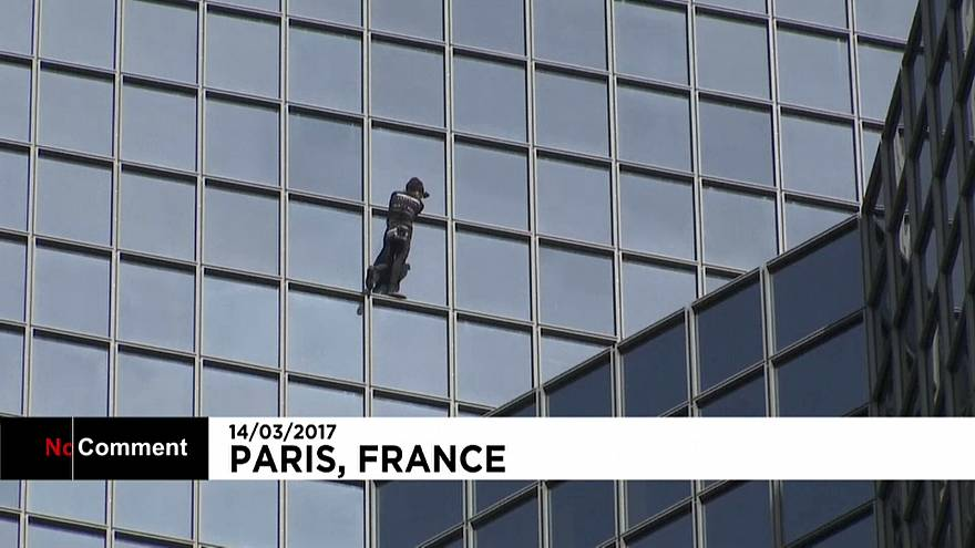 French climber Alain Robert scales skyscraper in Paris business district