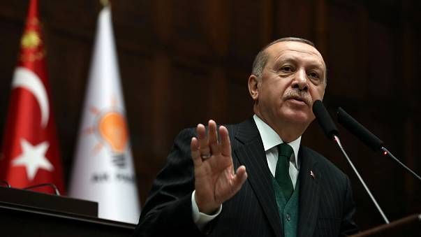 Turkish President Tayyip Erdogan addresses members of parliament