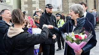 May fist bumps and poses for selfies during Salisbury visit