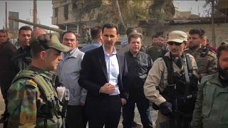 Assad visits troops in Ghouta as civilians flee