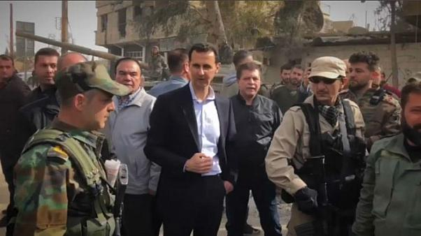 Assad visits troops in Ghouta as civilians flee