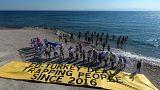 Amnesty activists with migrants stuck on Samos island last summer