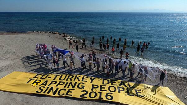 Amnesty activists with migrants stuck on Samos island last summer