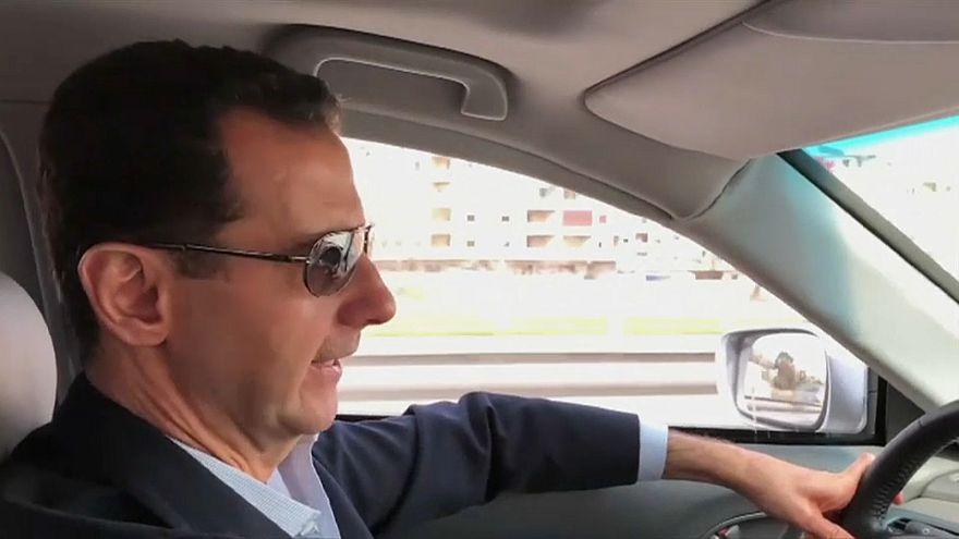 Assad filmed driving himself to the front lines of Syrian civil war