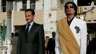 Libya's President Muammar Gaddafi (R) and his counterpart from France Nicol