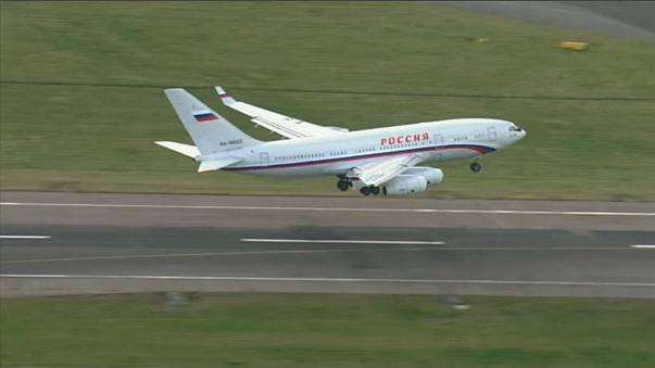 Russia defiant as its diplomats arrive home