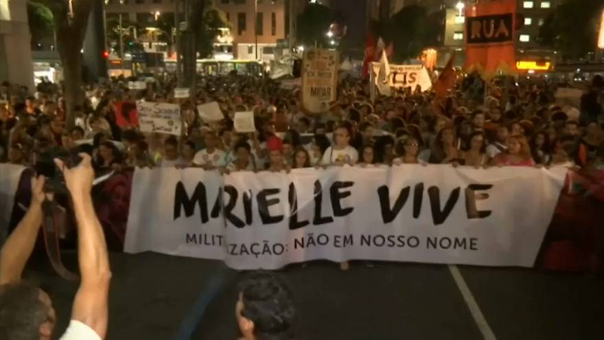 Brazilians mourn the killing of a human rights activist and demand justice as murder rate increases