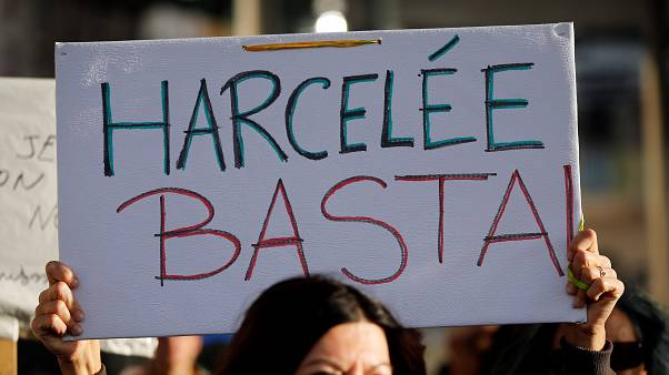 A placard is held during a protest against sexual violence in Marseille