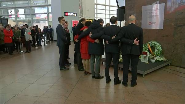Brussels airport observes a minute of silence marking anniversary of attcks