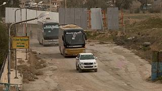 Coaches filled with opposition fighters are leaving Ghouta