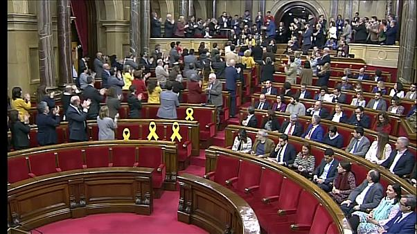 Catalan parliament suspends vote on detained new president
