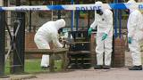 Forensic experts remove bench where Skripal was found