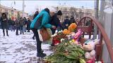 Tributes laid to victims of Russian shopping centre fire tragedy