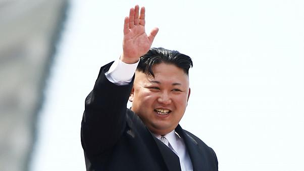 File photo: Kim Jong Un waves to crowds at a military parade in Pyongyang