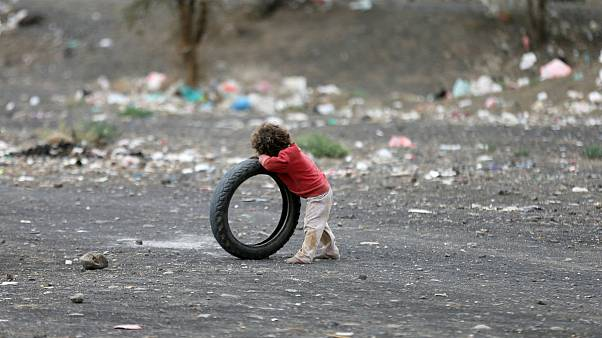Boy leans on a tyre at a camp for internally displaced people near Sanaa