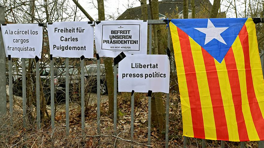 A Catalan separatist flag) is seen next to slogans in Neumuenster, Germany