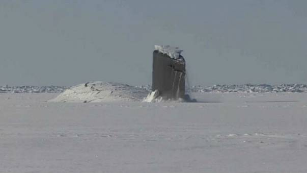 Watch: US submarine surfaces from Arctic Ocean
