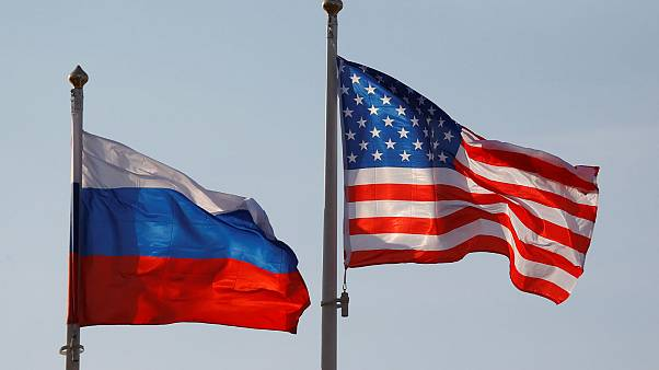National flags of Russia and the U.S. fly at Vnukovo International Airport
