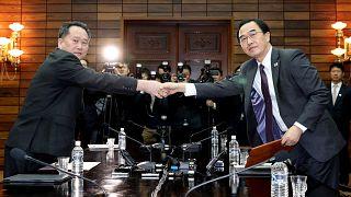 South Korean Minister Cho Myoung-gyon with his North Korean counterpart