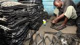 A man makes footwear from tyres in Ngara market, near Nairobi.
