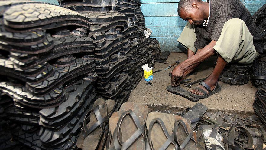 A man makes footwear from tyres in Ngara market, near Nairobi.