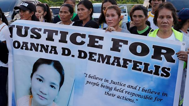 Residents display placards Joanna Demafelis