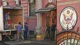 U.S. diplomatic staff load truck outside St Petersburg consulate