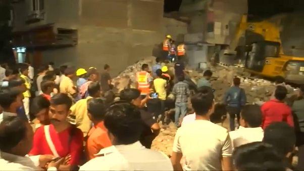 At least ten die as car brings down building in India