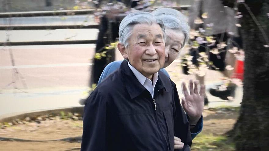 Japan`'s  Emperor and Empress enjoying cherry blossoms