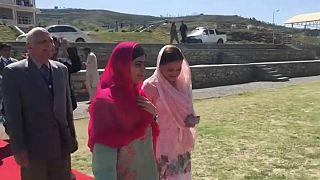 Malala returns to Britain after visiting homeland