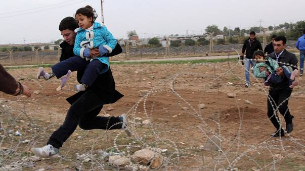 File photo: Syrians flee from the town of Ras al-Ain to Turkey in 2012