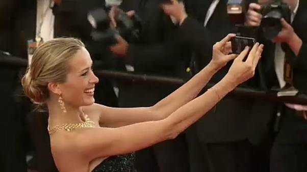 Petra Nemcova taking a selfie on the Cannes red carpet in 2014