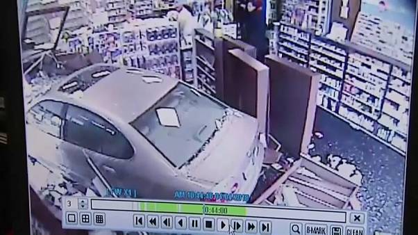 car crashed through the doors of a pharmacy in maryland