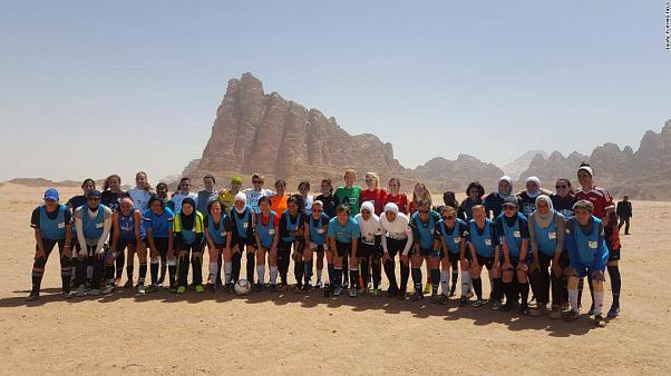 Footballers go low to set world record match at Dead Sea