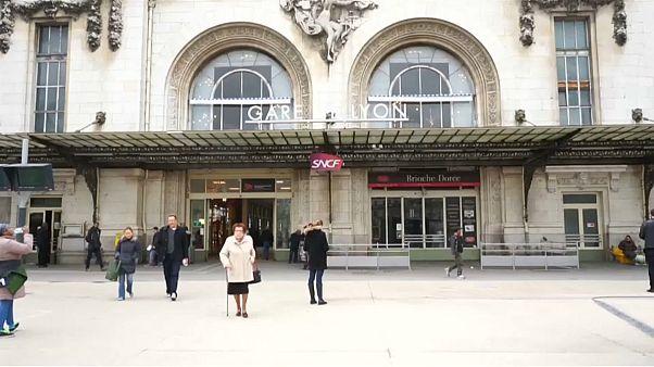 Paris suburban line passengers enter train through windows