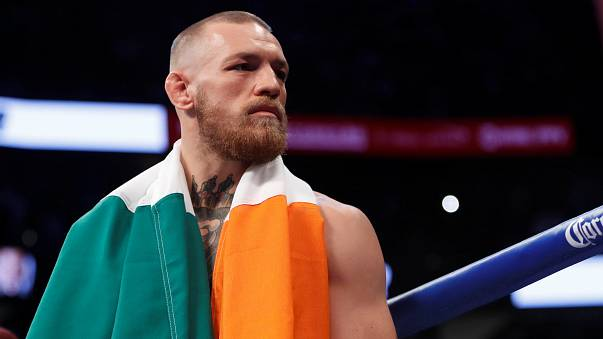 UFC fighter McGregor turns himself in to police after vandalizing a bus