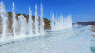 Ice-breaking detonations create spectacular scene on northeast China river