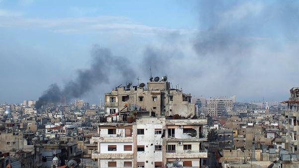 FILE PHOTO: Smoke rises from one of the buildings in the city of Homs