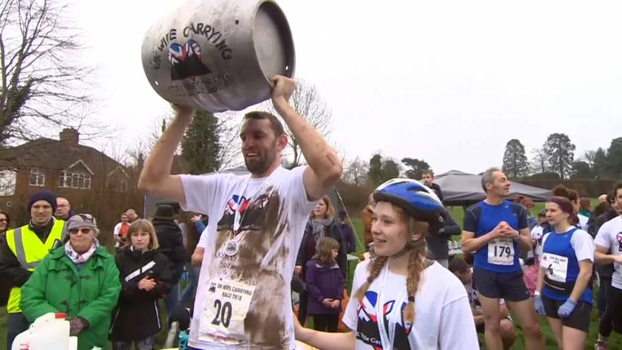 UK Wife-Carrying champion Chris Hepworth celebrates with Tanisha Prince.