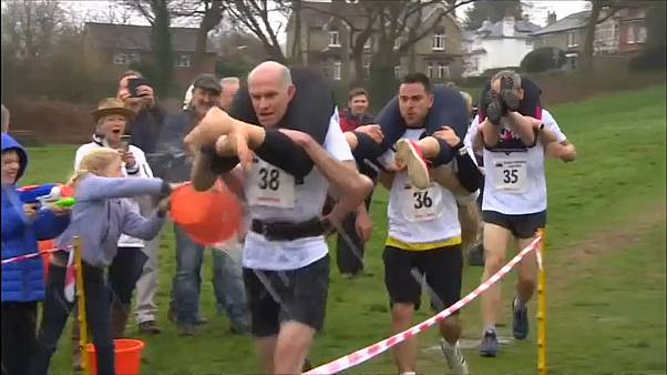 Couples face slips and tricks in UK wife-carrying champs