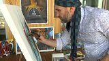 La storia di Ahmed, poliziotto di giorno e artista di notte