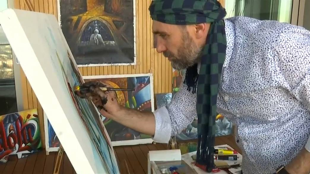 Police officer Ahmet Sula prefers painting to bullets