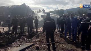 Rescuers at the scene of the crashed military aircraft