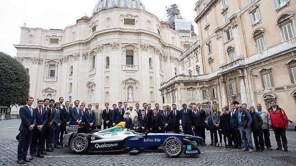 Pope Francis poses next a Formula-E electric racing car
