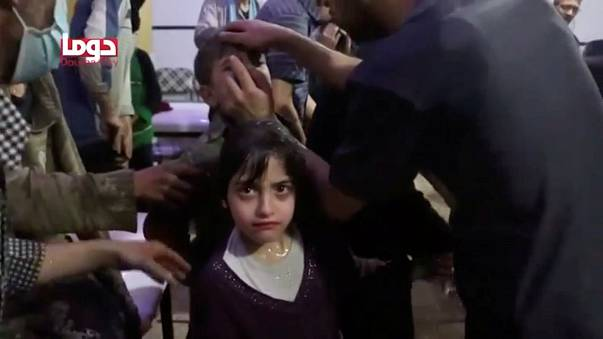 Girl looks on following alleged chemical weapons attack, said to be Douma