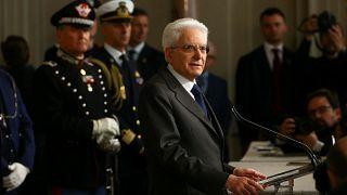 Italy's President Sergio Mattarella speaks to reporters