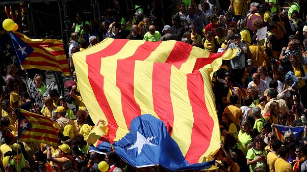 Independence supporters hold up a giant Catalan flag