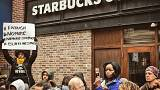 Starbucks apologises amid 'racial profiling' row