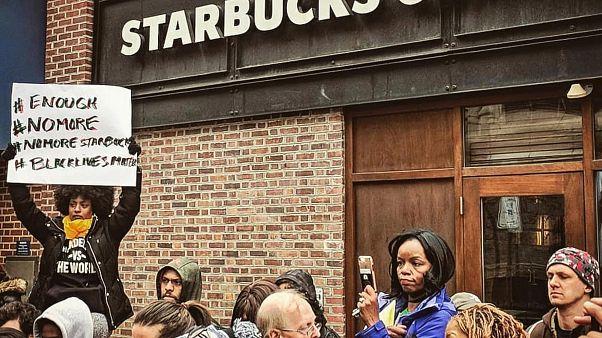 Starbucks apologises amid 'racial profiling' row
