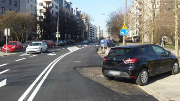 Polish pragmatism: city tarmacs around car blocking road renovation